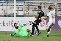 CARY, NC - AUGUST 01: Matt Vanoekel #1 makes a save in front of DJ Taylor #27 and Jonathan Dean #24 during a game between Birmingham Legion FC and North Carolina FC at Sahlen's Stadium at WakeMed Soccer Park on August 01, 2020 in Cary, North Carolina.