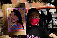 NEW YORK - NEW YORK - MARCH 21: A girl  holds a placard during a rally against Asian hate at Columbus Park in Chinatown on March 21, 2021 in New York. In the last two months, more than 500 attacks on Asians have been reported in United States. (Photo by John Smith/VIEWpress)