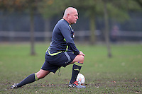 The match referee does his stretches before a Hackney & Leyton Sunday League match at Victoria Park - 01/11/09 - MANDATORY CREDIT: Gavin Ellis/TGSPHOTO - Self billing applies where appropriate - Tel: 0845 094 6026