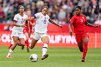 CARSON, CA - FEBRUARY 9: Lynn Williams #13 of the United States strikes the ball during a game between Canada and USWNT at Dignity Health Sports Park on February 9, 2020 in Carson, California.