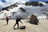 Tourists visiting the Dagu Glacier park on the south-east edge of the Tibetan Plateau in Sichuan Province, western China. The glacier has been shrinking in recent years, as a result of rising temperatures in the region.