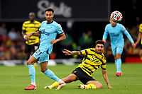 25th September 2021; Vicarge Road, Watford, Herts,  England;  Premier League football, Watford versus Newcastle; Ozan Tufan of Watford competes for the ball with Jacob Murphy of Newcastle United