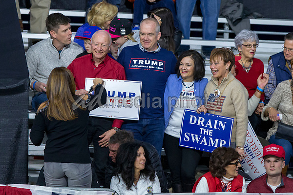 Supporters gather for a picture prior to a Make America Great Again campaign rally at Atlantic Aviation in Moon Township, Pennsylvania on March 10th, 2018. Photo Credit: Alex Edelman/CNP/AdMedia