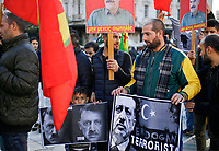 "Pictured: Kurdish protesters with a ""Dictator Erdogan"" banner gather at Syntagma Square in Athens Greece. <br /> Re: Kurdish people with protest against the Turkey president  Recep Tayyip Erdogan's visit to Greece. Thursday 07 December 2017"