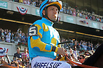 June 6, 2015: Heading to the post parade, a relaxed-looking Victor Espinoza blows bubbles. American Pharoah, Victor Espinoza up, wins the 147th running of the Grade I  Belmont Stakes and with it the Triple Crown at Belmont Park, Elmont, NY.  Joan Fairman Kanes/ESW/CSM