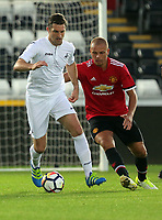 Sam Ricketts of Swansea Legends (L) during the Alan Tate Testimonial Match, Swansea City Legends v Manchester United Legends at the Liberty Stadium, Swansea, Wales, UK