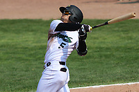 Beloit Snappers outfielder Victor Victor Mesa (5) swings at a pitch during a game against the Quad Cities River Bandits on July 18, 2021 at Pohlman Field in Beloit, Wisconsin.  (Brad Krause/Four Seam Images)