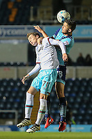 Alfie Lewis of West Ham United U21s and Danny Rowe of Wycombe Wanderers in an aerial battle during the The Checkatrade Trophy match between Wycombe Wanderers and West Ham United U21 at Adams Park, High Wycombe, England on 4 October 2016. Photo by David Horn.