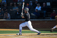 Ben Breazeale (9) of the Wake Forest Demon Deacons follows through on his swing against the Florida State Seminoles at David F. Couch Ballpark on April 16, 2016 in Winston-Salem, North Carolina.  The Seminoles defeated the Demon Deacons 13-8.  (Brian Westerholt/Four Seam Images)