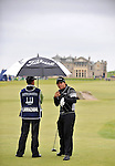 Pic Kenny Smith............. 02/10/2009.Dunhill Links Champioship, St Andrews  Links, Pablo Larrazabal shelters from the weather as he prepares to tee of on the 18th