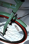 """[DENVER, CO   6/2/04] The front wheel of the Bianchi Milano (cq) in the color """"celeste"""", one of the cruiser bicycles at Turin Bicycles at 700 Lincoln St. in Denver.   .(Photo by ELLEN JASKOL/ROCKY MOUNTAIN NEWS)"""