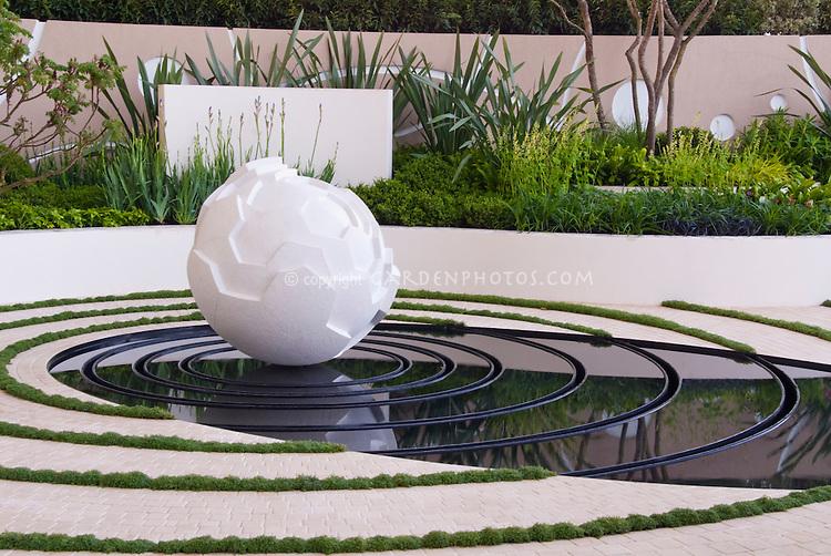 Meditation garden pond with concentric circles & ornamental modern sculpture