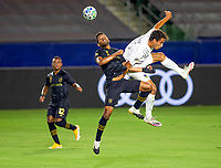 CARSON, CA - SEPTEMBER 06: Jose Cifuentes #11of LAFC battles Ethan Zubak #29 of the Los Angeles Galaxy battle in the air during a game between Los Angeles FC and Los Angeles Galaxy at Dignity Health Sports Park on September 06, 2020 in Carson, California.