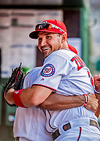 26 September 2018: Washington Nationals first baseman Ryan Zimmerman gets a hug in the dugout prior to a game against the Miami Marlins at Nationals Park in Washington, DC. The Nationals defeated the visiting Marlins 9-3, closing out Washington's 2018 home season. Mandatory Credit: Ed Wolfstein Photo *** RAW (NEF) Image File Available ***