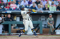 Michigan Wolverines second baseman Ako Thomas (4) swings the bat against the Vanderbilt Commodores during Game 1 of the NCAA College World Series Finals on June 24, 2019 at TD Ameritrade Park in Omaha, Nebraska. Michigan defeated Vanderbilt 7-4. (Andrew Woolley/Four Seam Images)