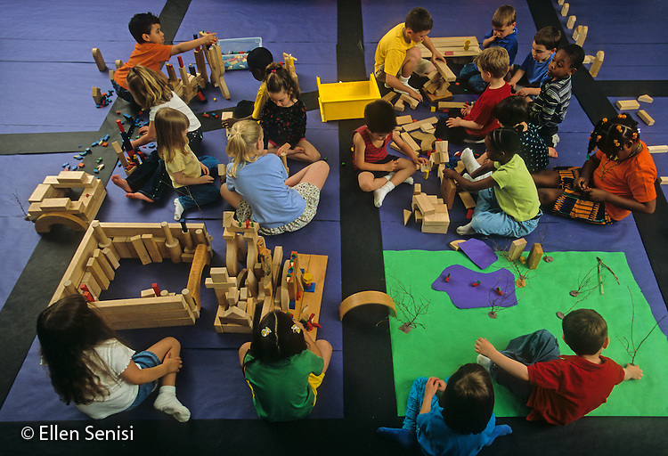 MR / Schenectady, New York. Yates Arts in Education Magnet School (urban public school).Mixed ages (4-8) multi-grade (Pre-K -3) students work together to create imaginary community using blocks and paper. ID: L-C. ©Ellen B. Senisi
