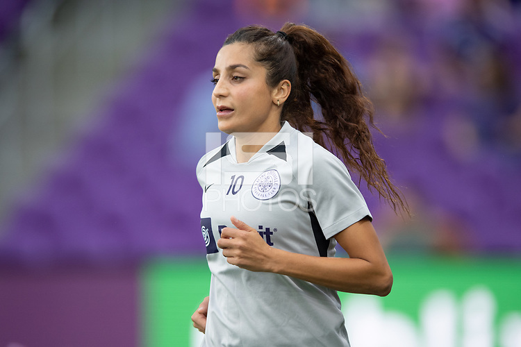 ORLANDO, FL - SEPTEMBER 11: Nadia Nadim #10 of Racing Louisville FC runs out to the warmups before a game between Racing Louisville FC and Orlando Pride at Exploria Stadium on September 11, 2021 in Orlando, Florida.