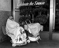 Homeless woman sleeping outside File's Department Store on Washington Street Boston MA November,1989