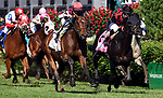 LOUISVILLE, KY - MAY 06: Divisidero #2, ridden by Julien Leparoux, wins the Woodford Reserve Turf Classic Stakes  ahead of Beach Patrol #8, ridden by Florent Geroux, on Kentucky Derby Day at Churchill Downs on May 6, 2017 in Louisville, Kentucky. (Photo by Jessica Morgan/Eclipse Sportswire/Getty Images)
