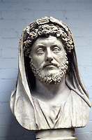 Greek Art:  Marcus Aurelius, head of a large statue, veiled and wearing a wreath of corn, AD 170-180.  Possibly as member of College of Arval Brethren who sacrificed to Dea Dia, Goddess of Abundant Harvests.  Photo '90.