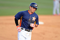 Houston Astros third baseman Brandon Laird #4 rounds third after hitting a home run during a Spring Training game against the St. Louis Cardinals at Osceola County Stadium on March 1, 2013 in Kissimmee, Florida.  The game ended in a tie at 8-8.  (Mike Janes/Four Seam Images)