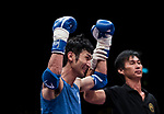 The judge rises the arm of Nitamizu Toshiyuki (Blue) of Japan as he wins the gold medal in the male muay 57KG division weight bout during the East Asian Muaythai Championships 2017 at the Queen Elizabeth Stadium on 13 August 2017, in Hong Kong, China. Nitamizu Toshiyuki won the gold over Lam Lit Tung of Hong Kong. Photo by Yu Chun Christopher Wong / Power Sport Images