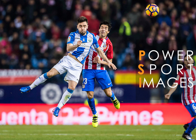 Unai Lopez of Deportivo Leganes competes for the ball with Nicolas Gaitan of Atletico de Madrid during their La Liga match between Atletico de Madrid and Deportivo Leganes at the Vicente Calderón Stadium on 04 February 2017 in Madrid, Spain. Photo by Diego Gonzalez Souto / Power Sport Images