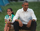 United States President Barack Obama sits next to Girl Scout Daphnye Shell, 9, of Peggs, Oklahoma, during a campout on the South Lawn of the White House June 30, 2015 in Washington, DC. The president and first lady Michelle Obama hosted the event as part of the first lady's Let's Move! Outside initiative and for Girl Scouts to earn the new Girls' Choice Outdoor badge. <br /> Credit: Chip Somodevilla / Pool via CNP