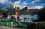 The Village Pub. Scarlett or Scarlet Arms. Walliswood, Surrey, England. Pub sign spelling is different from that painted on exterior wall of public house. 1990s 1991