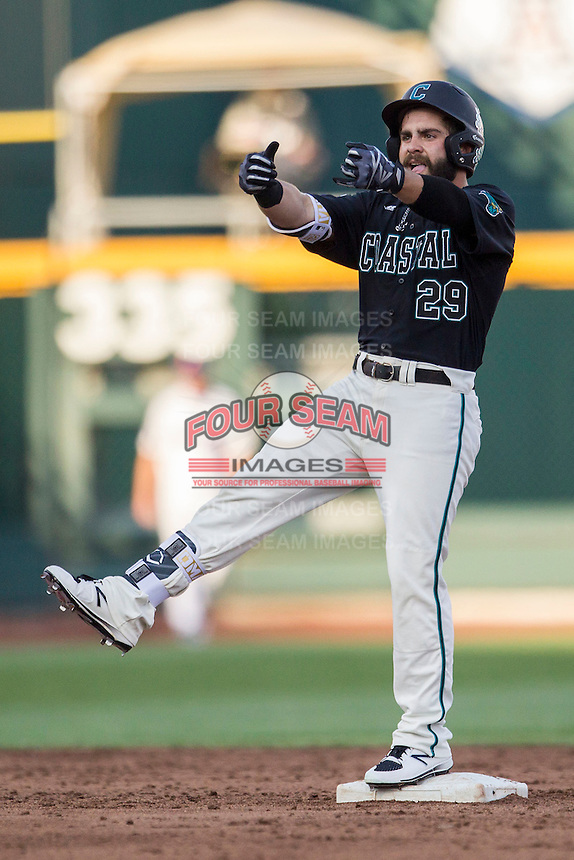 Coastal Carolina Chanticleers outfielder Anthony Marks (29) celebrates hitting a double against the Florida Gators in Game 4 of the NCAA College World Series on June 19, 2016 at TD Ameritrade Park in Omaha, Nebraska. Coastal Carolina defeated Florida 2-1. (Andrew Woolley/Four Seam Images)
