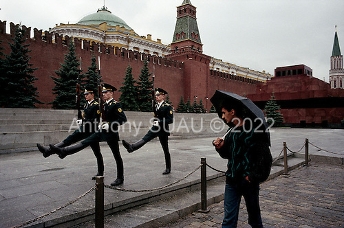 """Moscow, Russia<br /> Soviet Union<br /> August 30, 1991<br /> <br /> The guards at Lenin's Mausoleum in Red Square goose-stepping off during their shift change. Thie spectacle stopped on October 7, 1993.<br /> <br /> In December 1991, food shortages in central Russia had prompted food rationing in the Moscow area for the first time since World War II. Amid steady collapse, Soviet President Gorbachev and his government continued to oppose rapid market reforms like Yavlinsky's """"500 Days"""" program. To break Gorbachev's opposition, Yeltsin decided to disband the USSR in accordance with the Treaty of the Union of 1922 and thereby remove Gorbachev and the Soviet government from power. The step was also enthusiastically supported by the governments of Ukraine and Belarus, which were parties of the Treaty of 1922 along with Russia.<br /> <br /> On December 21, 1991, representatives of all member republics except Georgia signed the Alma-Ata Protocol, in which they confirmed the dissolution of the Union. That same day, all former-Soviet republics agreed to join the CIS, with the exception of the three Baltic States."""