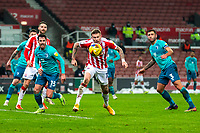 2nd January 2021; Bet365 Stadium, Stoke, Staffordshire, England; English Football League Championship Football, Stoke City versus Bournemouth; James McClean of Stoke City heads the ball out