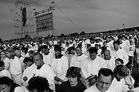 Czech monks pray during the open-air mass served by the Pope Benedict XVI in Stara Boleslav, one of the main pilgrimage site of the Czech Republic, September 28, 2009.