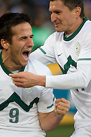 Slovenia's (9) Zlatan Ljubijankic celebrates his goal with teammate  Andraz Kirm  (17) during the first half of the 2010 World Cup match between USA and Slovenia at Ellis Park Stadium in Johannesburg, South Africa on Friday, June 18, 2010.  The USA tied Slovenia 2-2.