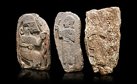 Hittite monumental relief sculptures, 900 - 700 BC, from Adana Archaeology Museum, Turkey. Against a black background