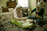Turkish women looking after a baby in Istanbul, Turkey