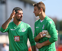 Julian Speroni of Crystal Palace (left) offers some words of advice to Chris Kettings of Crystal Palace (right) after the Friendly match between Barnet and Crystal Palace at The Hive, London, England on 11 July 2015. Photo by David Horn.