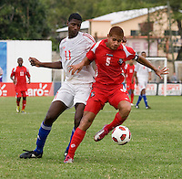 Daniel Luiz Saez (11) of Cuba tries to take the ball away from Roberto Chen (5) of Panama during the group stage of the CONCACAF Men's Under 17 Championship at Jarrett Park in Montego Bay, Jamaica. Panama tied Cuba, 0-0.