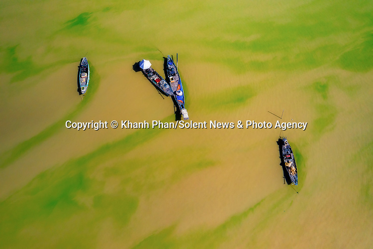 An algae-covered lake looks like an oil painting due to its remarkable colours.  Fishing boats travelling on the green and yellow water look surreal in the aerial photographs.<br /> <br /> The water at Tri An Lake, Vietnam, is 'dyed' like this due to a large presence of algae this time of year.  SEE OUR COPY FOR DETAILS<br /> <br /> Please byline: Khanh Phan/Solent News<br /> <br /> © Khanh Phan/Solent News & Photo Agency<br /> UK +44 (0) 2380 458800