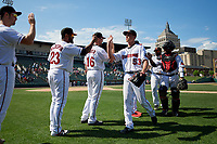 Rochester Red Wings pitcher Cody Stashak (53) and catcher Tomas Telis (18) high five Wynston Sawyer (16) and Jordany Valdespin (23) after an International League game against the Scranton/Wilkes-Barre RailRiders on June 25, 2019 at Frontier Field in Rochester, New York.  Rochester defeated Scranton 10-9.  (Mike Janes/Four Seam Images)