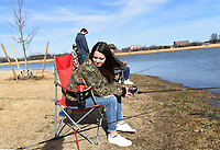 Alexis Vidal checks her fishing pole on Dec. 26 2020 at Lake Bentonville.<br />(NWA Democrat-Gazette/Flip Putthoff)