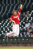 Houston Cougar first baseman Justin Montemayor #20 leaps to catch a line drive against the Texas A&M Aggies in the NCAA baseball game on March 1st, 2013 at Minute Maid Park in Houston, Texas. Houston defeated Texas A&M 7-6. (Andrew Woolley/Four Seam Images).