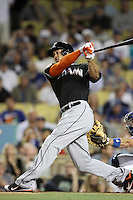 Giancarlo Stanton #27 of the Miami Marlins bats against the Los Angeles Dodgers at Dodger Stadium on August 24, 2012 in Los Angeles, California. Los Angeles defeated Miami 11-4. (Larry Goren/Four Seam Images)