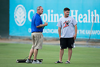 Kannapolis Intimidators manager Justin Jirschele (right) inspects the wet outfield with General Manager Randy Long prior to the game against the West Virginia Power at Kannapolis Intimidators Stadium on June 17, 2017 in Kannapolis, North Carolina.  The Power defeated the Intimidators 6-1.  (Brian Westerholt/Four Seam Images)