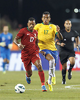 Portugal forward Nani (17) brings the ball forward as Brazil midfielder Luiz Gustavo (17) closes. In an international friendly, Brazil (yellow/blue) defeated Portugal (red), 3-1, at Gillette Stadium on September 10, 2013.