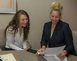Salome Manska, left, gets the details of her scholarship from Board Member Tricia Gallenbeck during the Nevada Women's Fund Scholarship distribution, June 20, 2019.