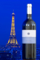 Eiffel Tower illuminated at night.  With a bottle of wine. Nordlund from Denmark. Paris, France.