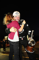 Nov. 13, 2011; Pomona, CA, USA; NHRA top fuel dragster driver Del Worsham celebrates with his daughter after winning the Auto Club Finals at Auto Club Raceway at Pomona. Mandatory Credit: Mark J. Rebilas-.
