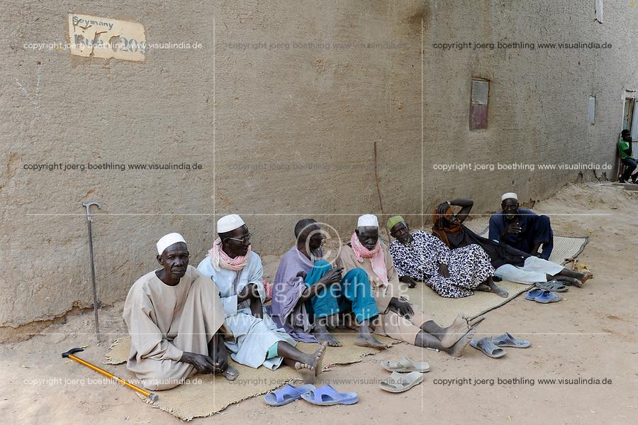 MALI, Djenne, muslim men sitting infront of clay building