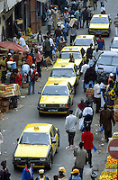 Senegal. Dakar. Sandaga market. One way traffic jam. Congested road with yellow taxi cars and people shopping. © 2000 Didier Ruef